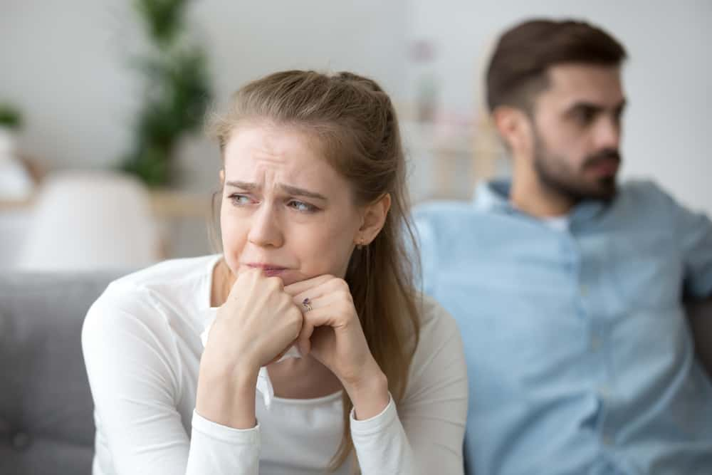 Woman trying not to cry after argument with her man